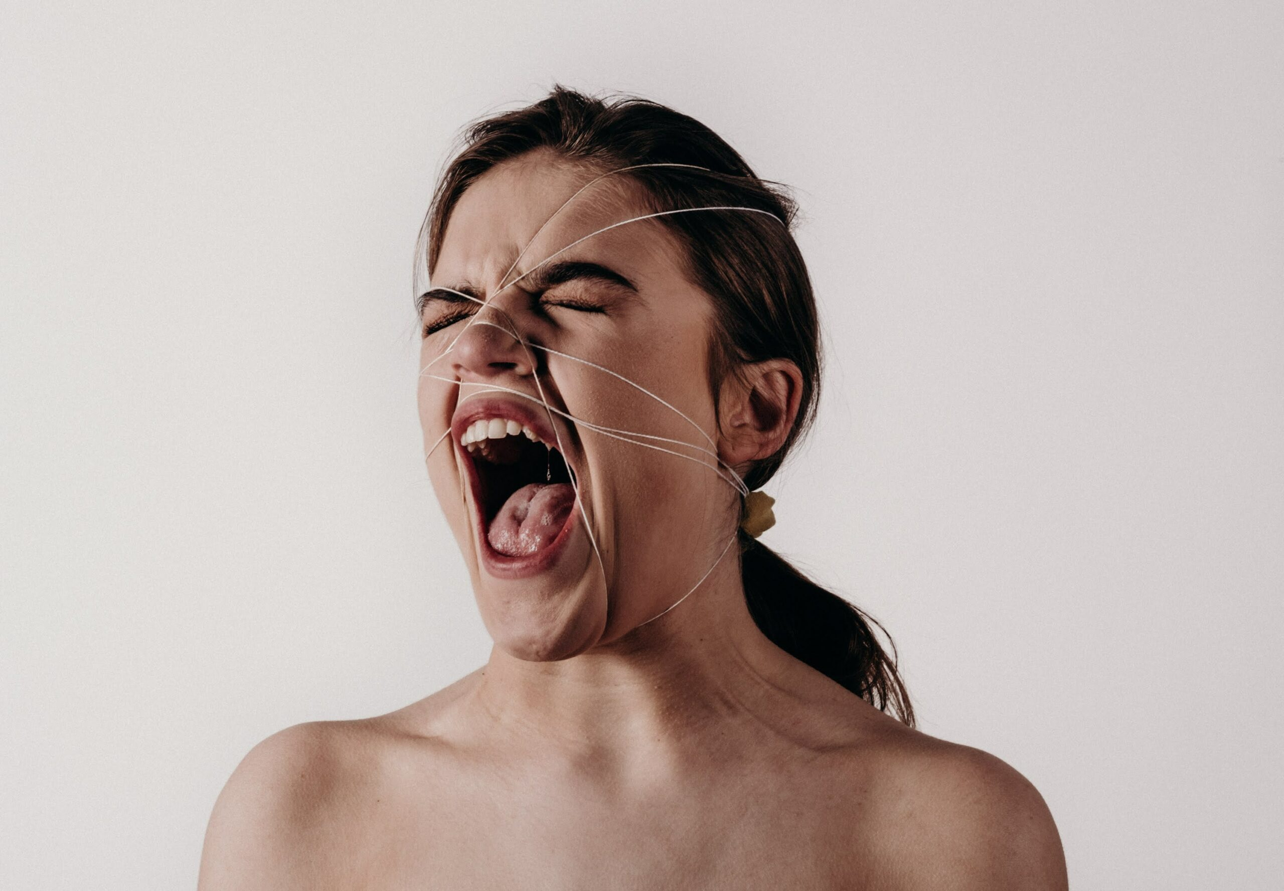 Woman with her head tied while screaming